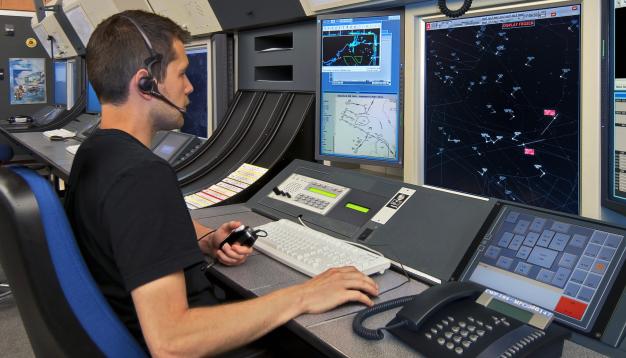 man working at a transportation dispatch station